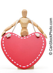 Wooden mannequin with large wooden red heart