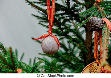 medieval bauble toy on green pine branch