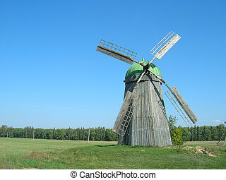 wooden mill on the field