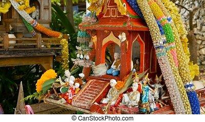 Wooden miniature guardian spirit house. Small buddhist...