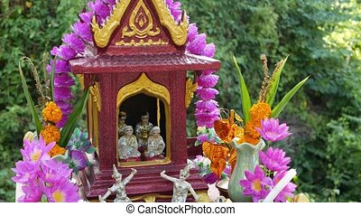 Wooden miniature guardian spirit house. Small buddhist...