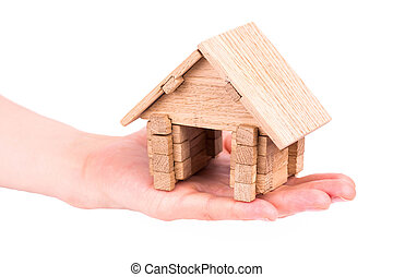Wooden model house in a hand
