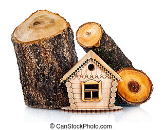 Wooden model of house and stack of wood. Concept