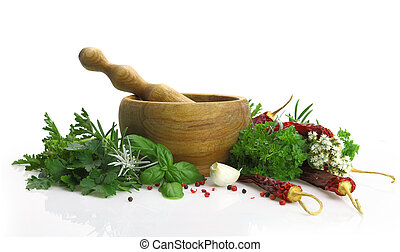 Wooden mortar and pestle with fresh herbs