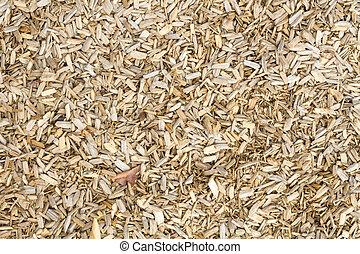 Wooden mulch on the ground in a garden