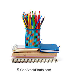 wooden multi-colored pencils, plastic pens and a stack of paper notebooks are isolated on a white background