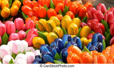 Wooden multi-colored tulips souvenirs and symbols of the...