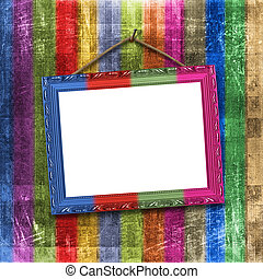 Wooden multicolored framework for portraiture on the striped...