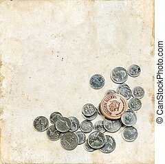 Wooden Nickel and Coins on a Grunge Background