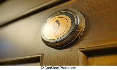 wooden number nine on the door close up
