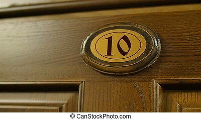 wooden number ten on the door close up