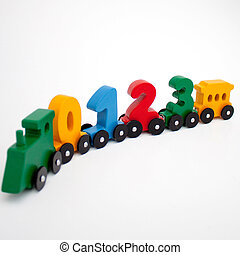 wooden numbers 0,1,2,3 letters train cars alphabet . Bright colors of red yellow green on a white background. Early childhood education, learning to count, preschool and kids game concept