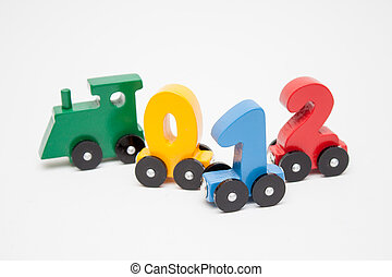 wooden numbers 0,1,2,4 letters train cars alphabet . Bright colors of red yellow green on a white background. Early childhood education, learning to count, preschool and kids game concept