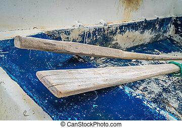 Wooden oars in old rowing boat