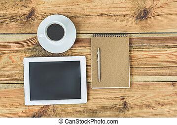 Wooden office desk with digital tablet