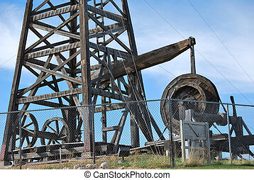 Wooden oil rig. - Vintage wooden drilling oil pump.