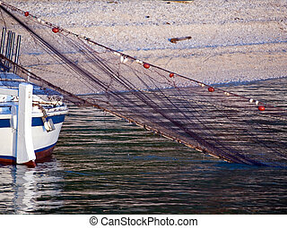 Wooden old boat and fisherman's net