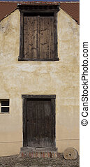 Wooden old door. Historical house door. Rural entry architecture element.