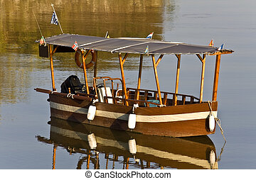 Wooden old traditional greek boat at lake Kerkini in Greece