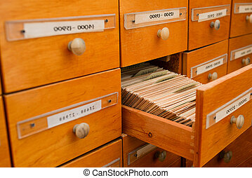 Wooden open drawer in the library. Directory of information files. Documents Archive