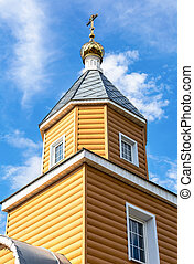 Wooden orthodox church against the sky