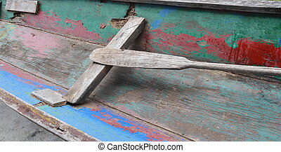 wooden paddle in old row boat
