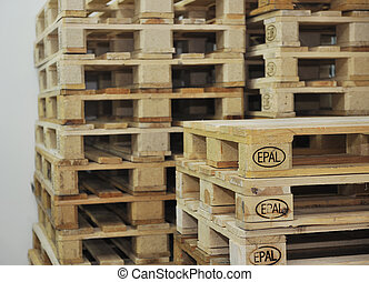 wooden palettes in warehouse for storage and euro transport