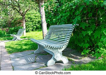 Wooden park bench at summer