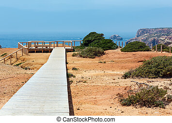 Wooden path and observation deck on summer Atlantic rocky ...
