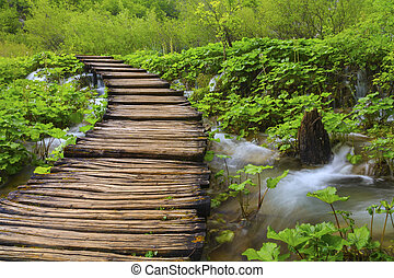 Wooden path near the lake at Plitvice on Lake