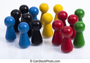 Wooden pawns isolated - Image shows a group of colored...