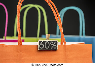 Wooden peg tag on shopping bags