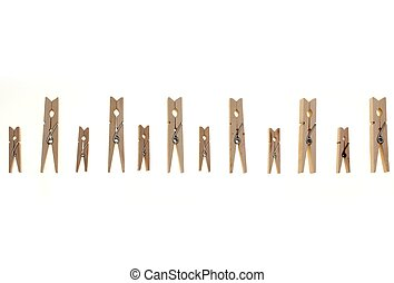 wooden pegs small and big isolated on white