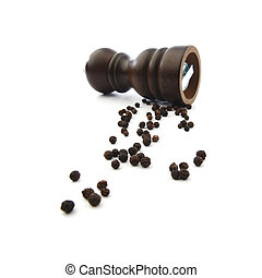 Wooden peppermill with peppercorns isolated on white ...