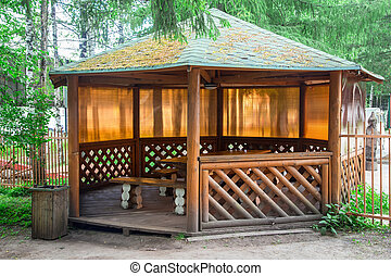 Photo of the wooden pergola during summer
