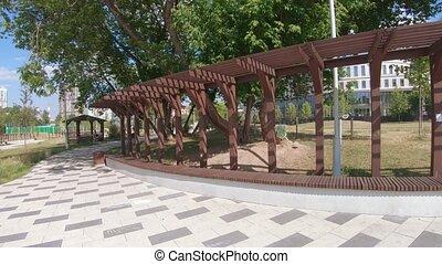 Wooden pergola in the park