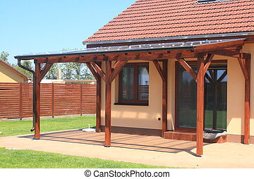 wooden pergola - Wooden pergola with a covering of...