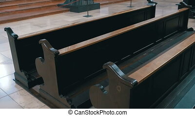 Wooden Pews in a Christian Church Aisle - MUNICH, GERMANY,...