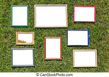 Wooden photo frames on spring lawn