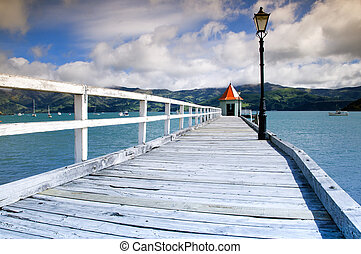 Wooden Pier at Akaroa Harbour in New Zealand.