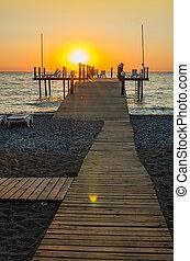 Wooden pier entering into the sea