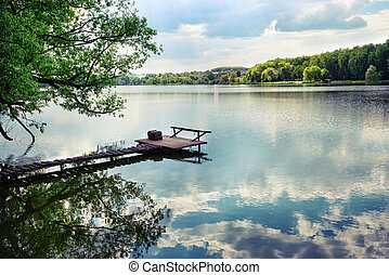 Wooden pier for fishing on the lake