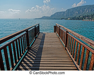 Wooden pier Garda Lake Italy
