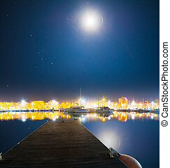 wooden pier in Alghero harbor at night
