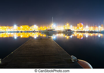 wooden pier in Alghero harbor