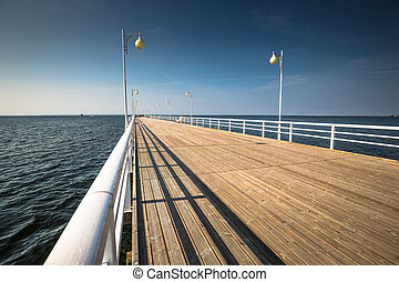 Wooden pier in Jurata town on coast of Baltic Sea, Hel peninsula, Poland