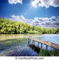 Wooden pier in the small lake