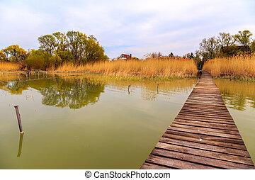 Wooden pier in tranquil lake Balaton