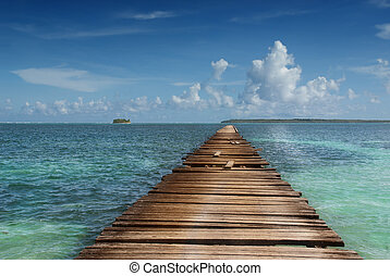 Wooden pier in tropical sea - Wooden pier pointing to...