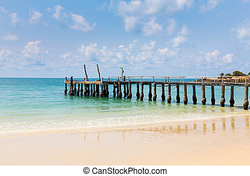 Wooden pier leading to the seacoast